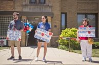 Teachers and staff lined the sidewalk in front of Betsy Ross School for the goodbye parade for Leslie Compere and Bill Milnamow on June 8. | Alex Rogals, Staff photographer