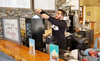 Amir Semsarieh uses the air roaster at Counter Coffee, now known as Kribi Coffee. | File photo