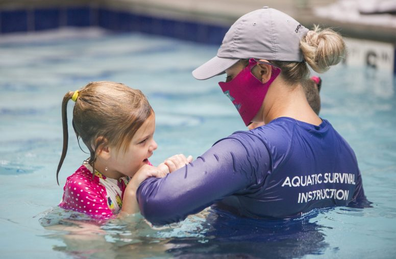 ISR certified swim instructor Claire Meza, right, guides Scotty Huber, 4, in the brand-new indoor pool at CAST Water Safety Foundation, 7628 Madison Street. | Alex Rogals, Staff Photographer