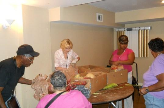 Volunteers sort food.