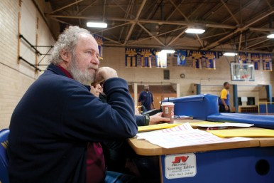 John Martin, the executive director of the Chicago Area Alternative Education League, takes in a game at Maryville Academy in Des Plaines.
