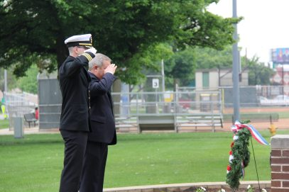 Mayor Anthony Calderone and U.S. Naval Commander Paul Roache lay a wreath at the Veteran's Memorial at the Park. Courtesy Rachell Entler, Park District of Forest Park.