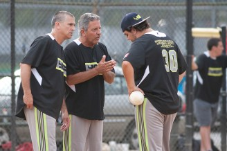 The pitcher from Yep gets a pep talk after allowing a couple of run-scoring hits. (David Pierini/staff photographer)