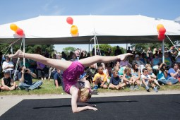 Kristi Taff does a hand-balancing act for the crowd.