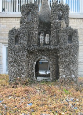 TINY KINGDOM: The miniature castles decorating the front and rear yards at 1001 Dunlop St. have been standing since 1927. (JOHN RICE/Contributor)