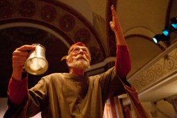 Gary Neubieser weaves in and out of the pews at St. John Lutheran Church in Forest Park as he sings the Wassail Carol during the Boar's Head Festival. (David Pierini/staff photographer)