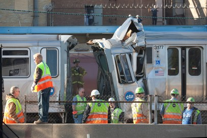 CTA and fire officials investigate the Sept. 30 train collision near the Blue Line platform at the Harlem Ave. stop in Forest Park.