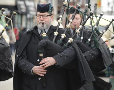 Bagpipers from the Doonaree Bagpipes perform during the parade. (Jennifer Wolfe/contributor)