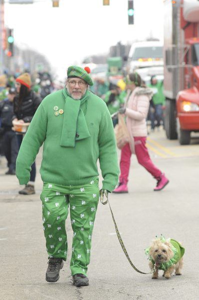 Jim Connelly of Chicago with his dog, Susie Q, walk in the St. Pat'rick's Day parade. (Jennifer Wolfe/contributor)