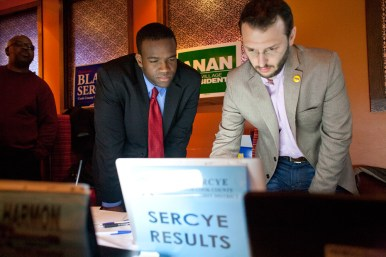 District 1 candidate Blake Sercye, left, and campaign volunteer Tom Bowen go over numbers Tuesday night at a campaign party at Maya del Sol in Oak Park. (David Pierini/staff photographer)