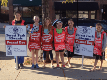 Members of Forest Park Youth Soccer pose on Madison Street. (JEAN LOTUS/Staff)