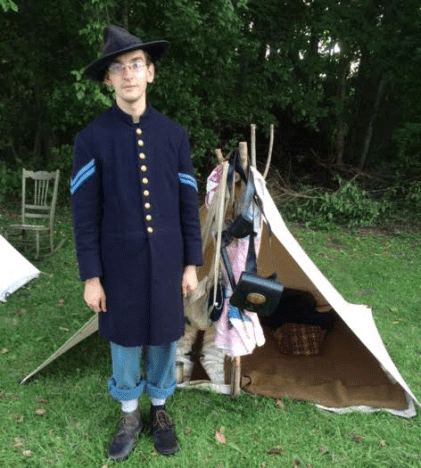 Civil War re-enactor Daniel Flora summons the persona of his great-great grandfather, William Butler Flora, a Union color-bearer for the 37th Kentucky Mounted Infantry. (Courtesy Brian Flora)