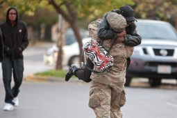 Dorothy Riddick tests the strength of her son, Spc. Kevin Riddick, after he got off the bus. Members of the Forest Park U.S. Army Reserve 300th Human Resources Company were welcomed home from Afghanistan Thursday at The Park. (David Pierini/staff photographer)