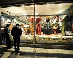 The Pippins perform in the window of Centuries and Sleuth's Bookstore in Forest Park during the Holiday Walk. (Jennifer Wolfe/Contributor)
