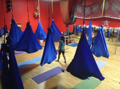 Fly Yoga practitioners at Pineapple Studios were suspended in blue bags Jan. 4 as they performed their moves at the studio open house. (Courtesy Erika Ochoa)