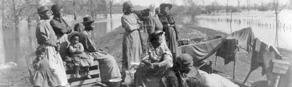 African American migrants wait on a levee for a boat to the North, April 17, 1897. (Courtesy Library of Congress)