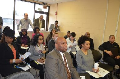 Attendees listen to bank representatives discuss credit building programs Jan. 21 at The Stable Project Meet and Greet event at 7th District Rep. Chris Welch's office in Westchester. Courtesy: Nicholas Samuel