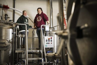 Owners of Exit Strategy Brewing, Katherine Valleau and Chris Valleau, at their soon-to-open shop, at 7700 Madison St. (CHANDLER WEST/Staff Photographer)