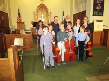 Cello and violin students from the Gasse Studio. | JACKIE SCHULZ/Contributor
