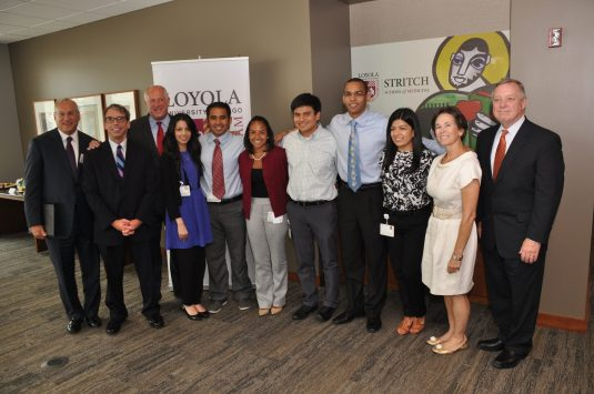 Dr. Mark Kuczewski (second from left) with former governor Pat Quinn (third from left) and Sen. Dick Durbin (far right) with the Stritch School of Medicine's DREAM class. | Courtesy Loyola Medical Center