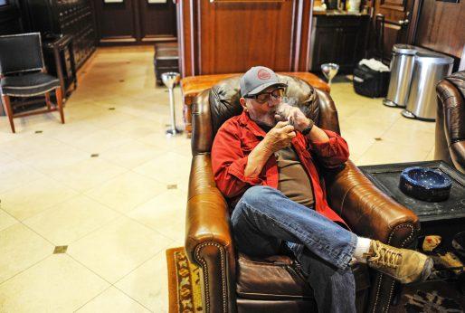 Ed Qurek enjoys a cigar during a break at Casa de Purros in Forest Park. | William Camargo/Staff Photographer