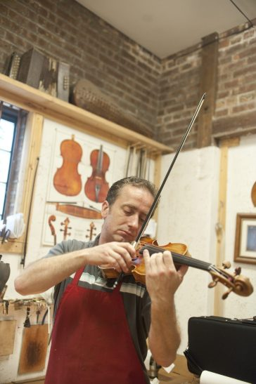 Bogdan Pawlikowski, Walter's son, plays a violin that he and his father made.   William Camargo/Staff Photographer