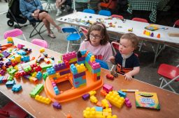 Kate Hampson and Vincent Schiavo play with toys during Opportunity Knocks' OK BBQ Block Party. | William Camargo/Staff Photographer
