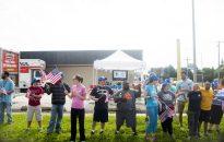 Fans wave flags at Madison and Forest. | William Camargo/Staff Photographer