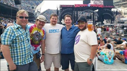 Friends and former Forest Park residents reunite for final Grateful Dead show. Left to right: Jackson Straugh (Kansas), Dustin Scrughs (Oklahoma), Frank Tower (Ohio), Sam Barain (Forest Park) and August Weste (California) at Soldier Field, July 5. Not pictured: Christina Respass (temporary homeless hippie hostel host). | Courtesy Christina Respass