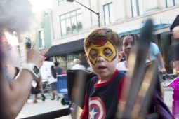 Aidan Contreras, 5, rounds out his superhero attire with face painting by Fanciful Faces.   Photo by Jasmyne Monaco