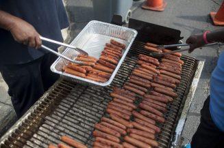Volunteers grill hot dogs. | William Camargo/Staff Photographer