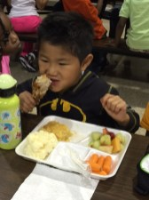 One Garfield student enjoying his lunch from the new lunch program.