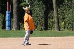 Dana Wax of the Warriors wears a fielding helmet. | William Camargo/Staff Photographer