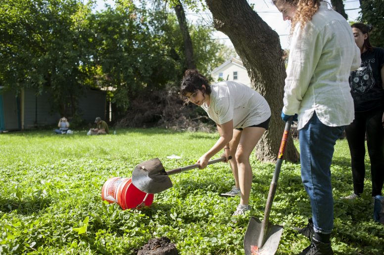 Marina Labarthe takes soil samples near a Maywood home. Students from DePaul University have been excavating as part of an archaeology class. | William Camargo/Staff Photographer