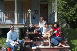 Katie Mumma, Emily Steinhauer, Stephanie Guthrie, Marina Labarthe, and Mercedes Johnson outside a Maywood house where they are looking for historic artifacts. | William Camargo/Staff Photographer