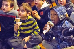 """Ernesto Bassen, left, and Omari Williams, right, eat ice cream while watching the screening of """"Sinful Sweets,"""" a new Food Network show that features The Brown Cow Ice Cream Parlor. 