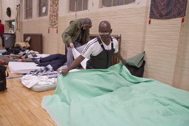 Terrence Monroe, 55, prepares his bed for the night at St. John Lutheran Church in Forest Park in 2014. | File 2014