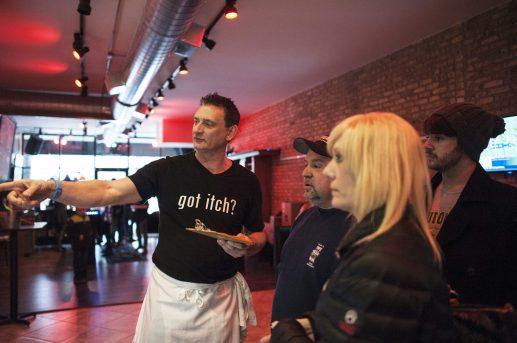 Patrick O' Brien orients customers on the new deli operation. | William Camargo/Staff Photographer