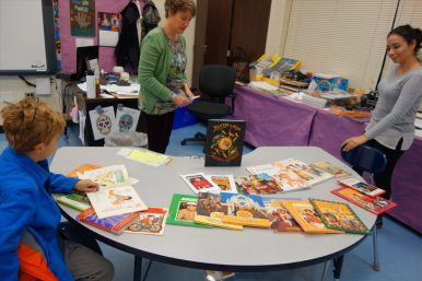 Photo Credit: Grace Finn ELL teachers Ms. Edwards and Ms. Reyes host a multicultural book room.