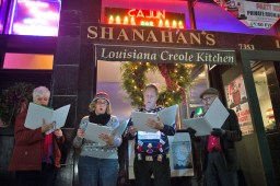 Carolers sing outside Shanahan's on Madison Street during Forest Park's Holiday Walk on Dec. 4. | Stacey Rupolo/Contributor