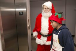 Santa with one of his helpers after hearing what all the children wanted him to bring them.   Rick Majewski/Contributor