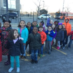 Happy Kindergarten students on their way in to the United Center.