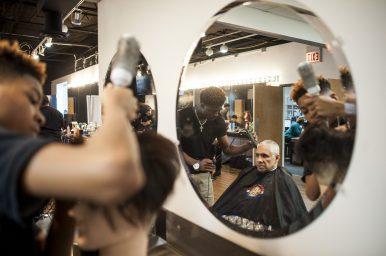 Damauri Harrell attends to a customer at Erskine Reeves' Barber Academy. | William Camargo/Staff Photographer