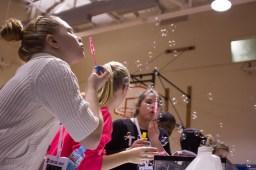 Samantha Smith, a fifth-grader at Field-Stevenson, blows bubbles at a demonstration involving baking soda and vinegar. | Stacey Rupolo/Contributor