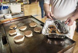 A volunteer makes blueberry pancakes. | William Camargo/Staff Photographer