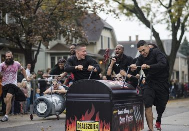 A Chevy Currie Motors team celebrates their heat win during the annual Casket Race in Forest Park last October. | File photo