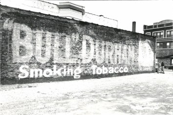 """The """"Bull"""" Durham Tobacco Company was popularized after the Civil War as and the """"brightleaf"""" tobacco was mailed to veterans who had the tobacco during the war. Salesmen traveled the country finding predominate buildings to put ads on the sides of buildings."""