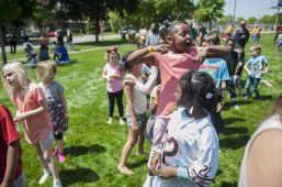 Children get excited as a magician prepares to come out. | William Camargo/Staff Photographer