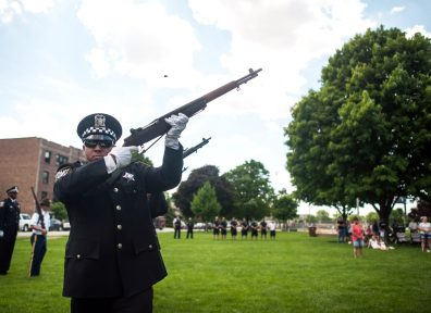 Forest Park police honor guard fire into the sky to commemorate fallen soldiers. | William Camargo/Staff Photographer