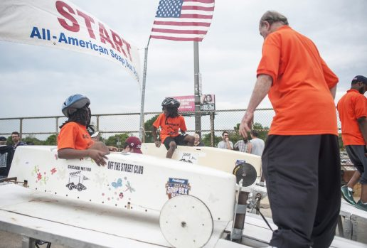 First races of the Soap Box Derby were delayed but not fully stopped, as members of the Chicago Metro Derby team prepare to begin. | William Camargo/Staff Photographer